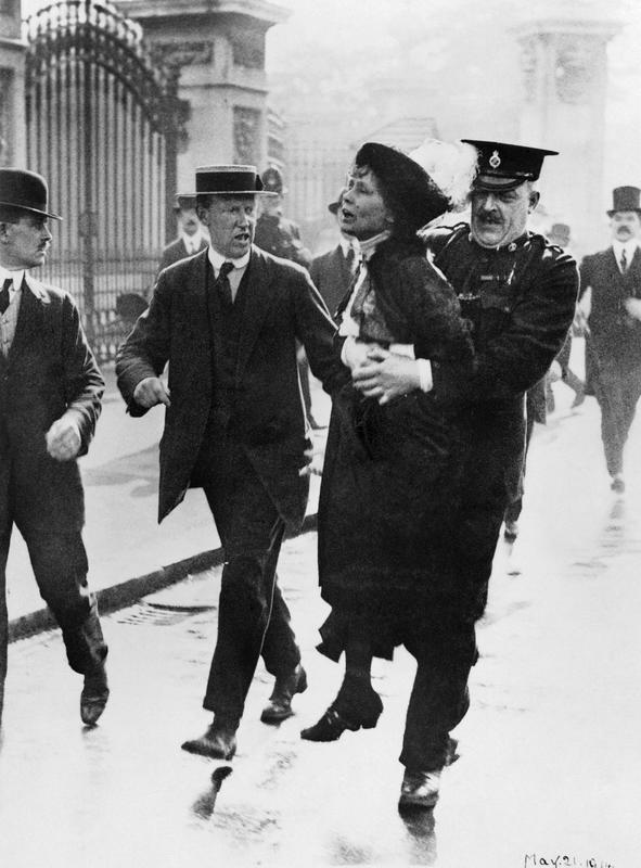Emmeline Pankhurst is arrested outside Buckingham Palace, attempting to hand in a petition. From IMW