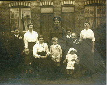 Sapper George Ramsdall outside his home, with family