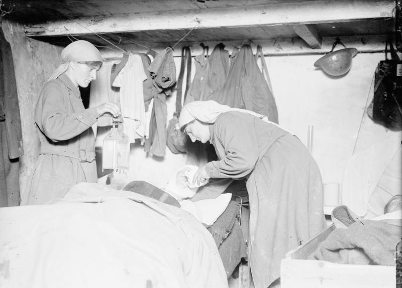 Elsie Knocker and Mairi Chisholm attending toa  wounded Belgian soldier in the third advanced first aid post at Pervyse, near Ypres.  From IWM