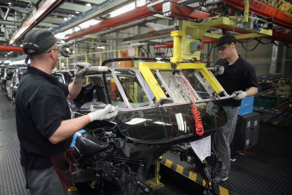 SUNDERLAND, ENGLAND - JANUARY 24:  A technician assembles a Nissan car on the production line at Nissan's Sunderland plant on January 24, 2013 in Sunderland, England. The Japanese manufacturer's factory employs 6,225 people producing the Juke, Note and Qashqai models. In 2012 the Wearside facility built 510,572 cars to become the first ever UK automobile plant to have produced more than half a million cars in a year, which was 34.8 percent of the cars produced in the whole of the UK for 2012.  (Photo by Christopher Furlong/Getty Images)