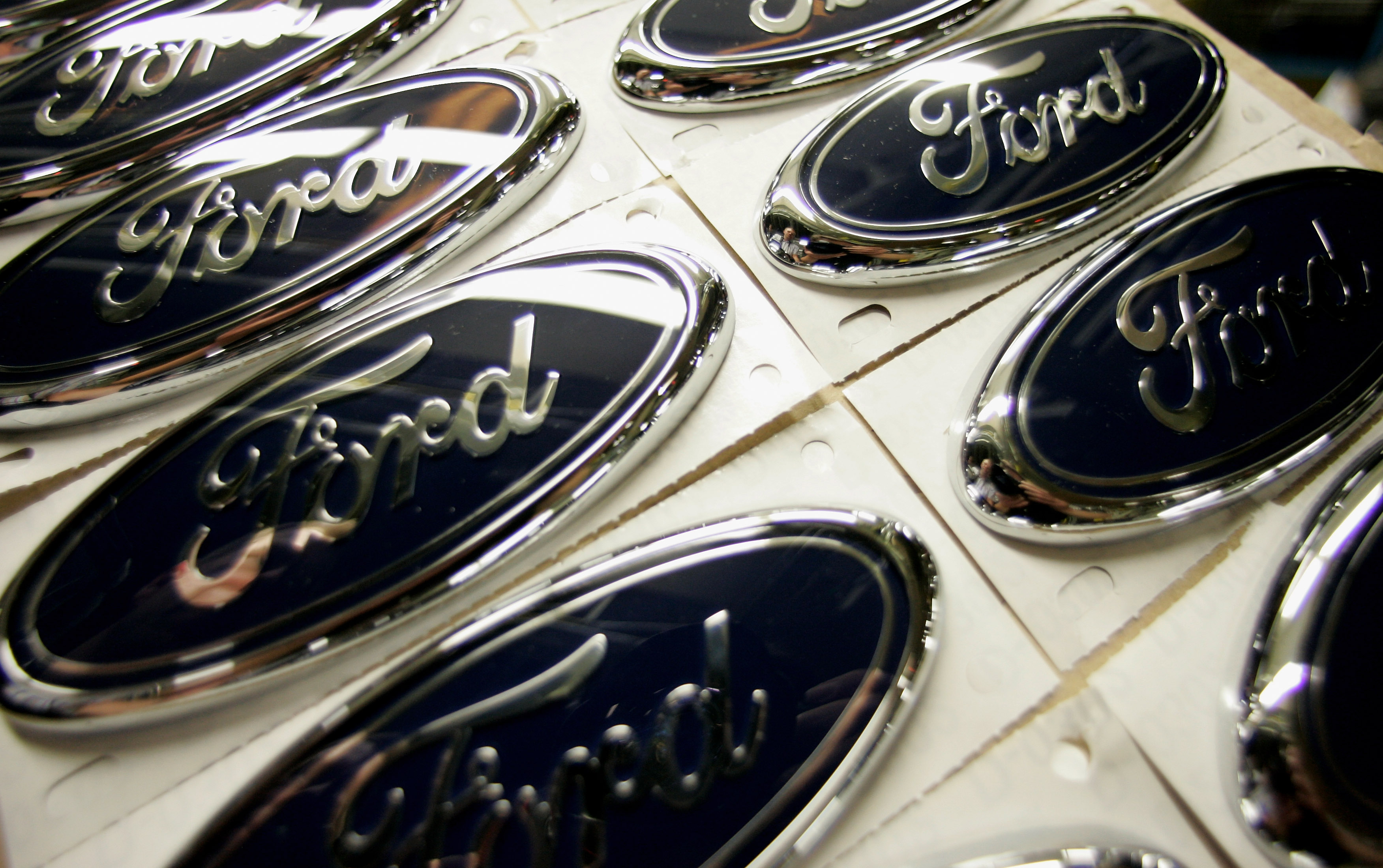 SAARLOUIS, GERMANY - APRIL 16:  Logos are pictured at the production line of a Ford Focus at the Ford plant on April 16, 2007 in Saarlouis, Germany. Ford Motor Co. the world's third - largest carmaker produces 1900 vehicles a day in Saarlouis, this is after last year's reorganization which reduced the number of Ford Plants in Europe from eleven to six.  (Photo by Ralph Orlowski/Getty Images)
