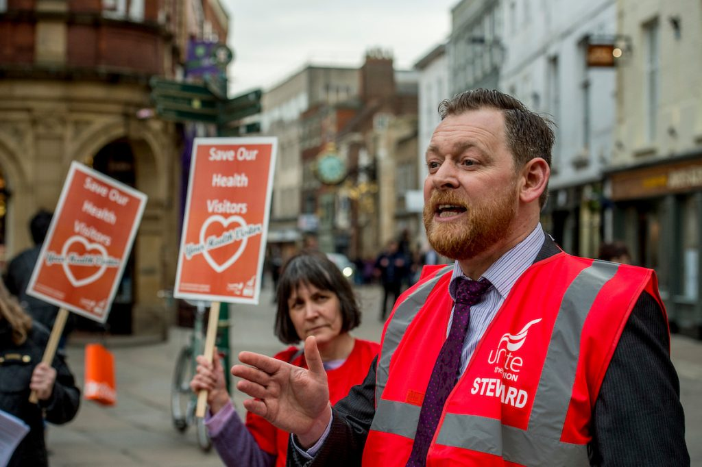 Mark Fieldhouse, Unite regional Officer, addresses Health Visitors and School nurses in York demonstrate outside the council offices in York