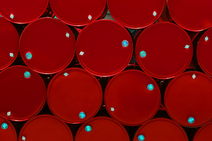 red steel chemical tanks or oil tanks stacked in a row. background and texture
