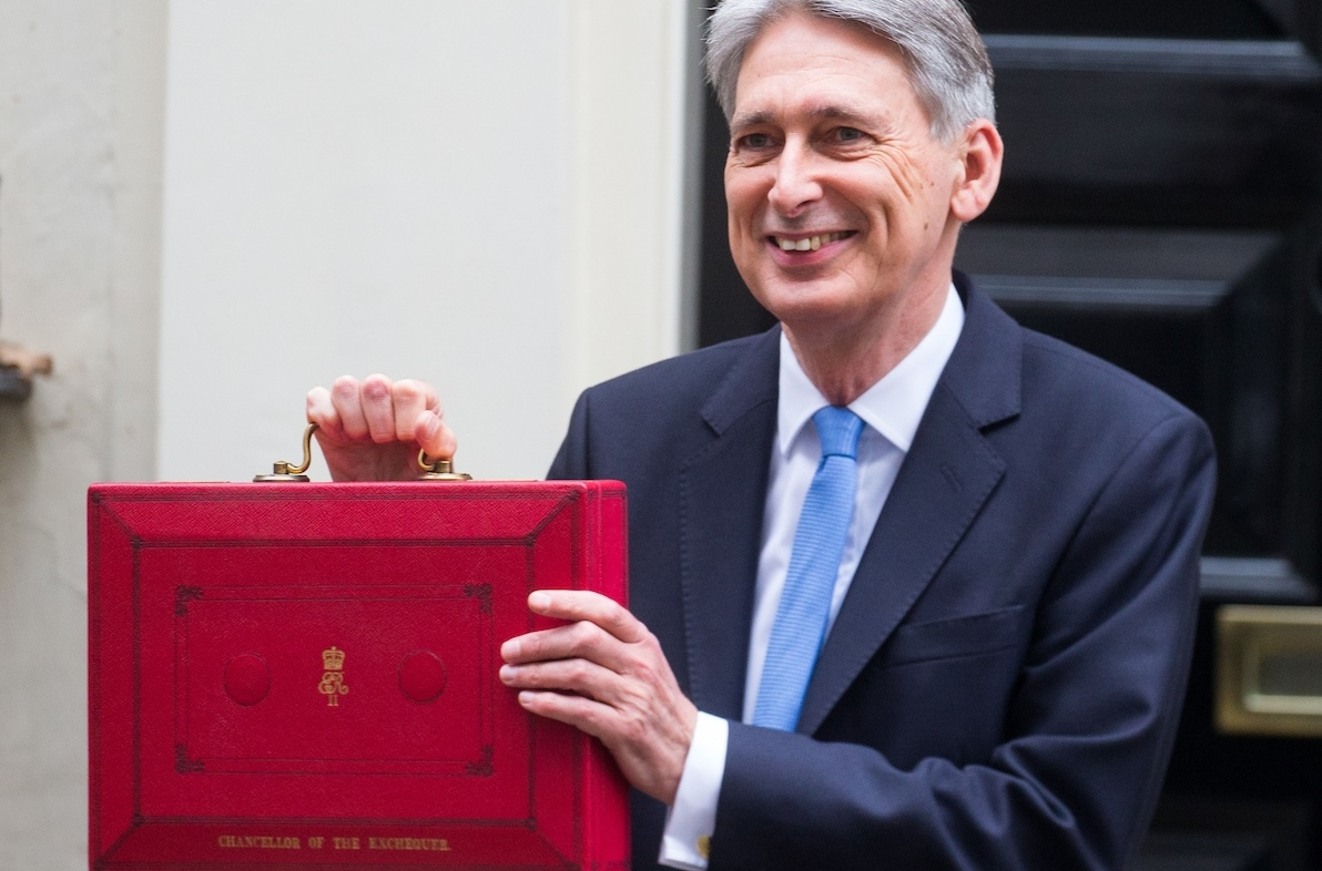 Chancellor of the Exchequer, Philip Hammond, holds the famous red box on the steps of Number 11 Downing street, before leaving for the Palace of Westminster to deliver it to the House
