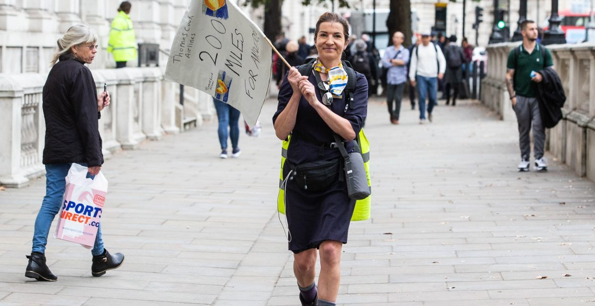 Ex Thomas Cook Cabin crew, Rachel Murrell, arrives at the gates of Downing Street after a 200 mile walk from Devon. She is highlighting the plight of the 9,000 workers thrown out of workafter the sudden collapseof the travel company. She tries to deliver a letter to the Prime Minister, Boris Johnson.